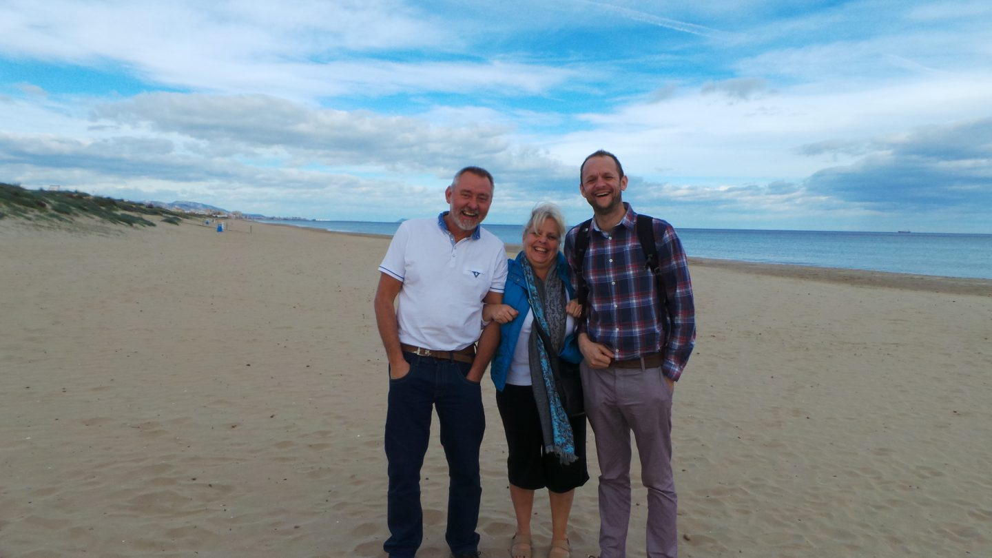 The family on Oliva Beach, Spain