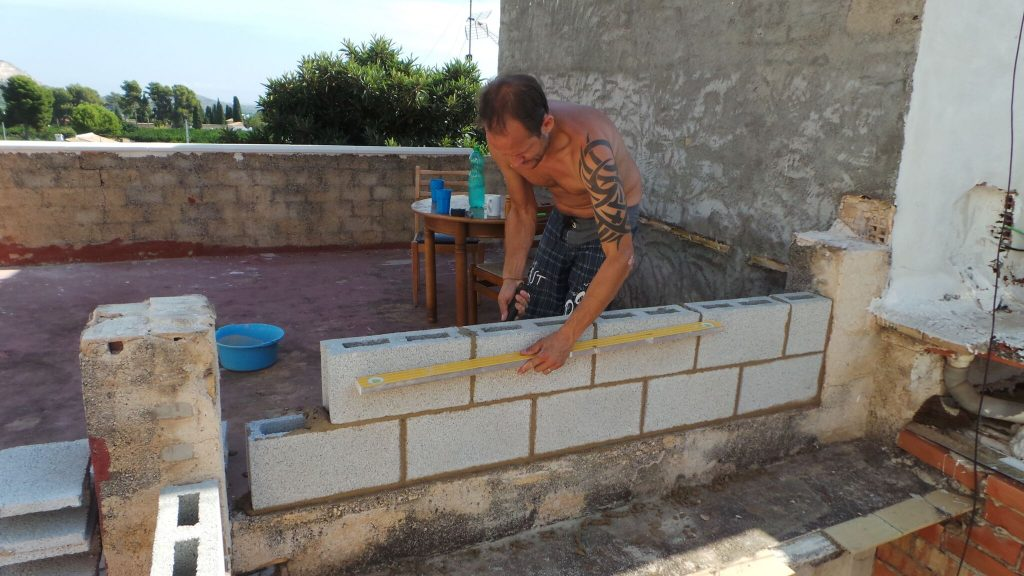 darren rebuilding terrace wall | metcalfememoir.co.uk