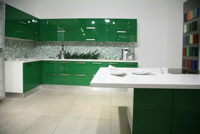 Glossy Green Kitchen interior Design With Black And White Mosaic Tile Backsplash Cabinet Furniture And White Granite Island